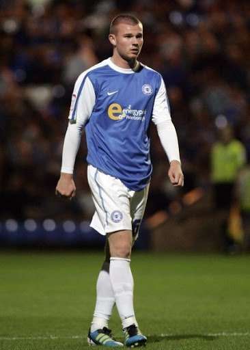 Ryan Tunnicliffe in action for Peterborough United in the Championship